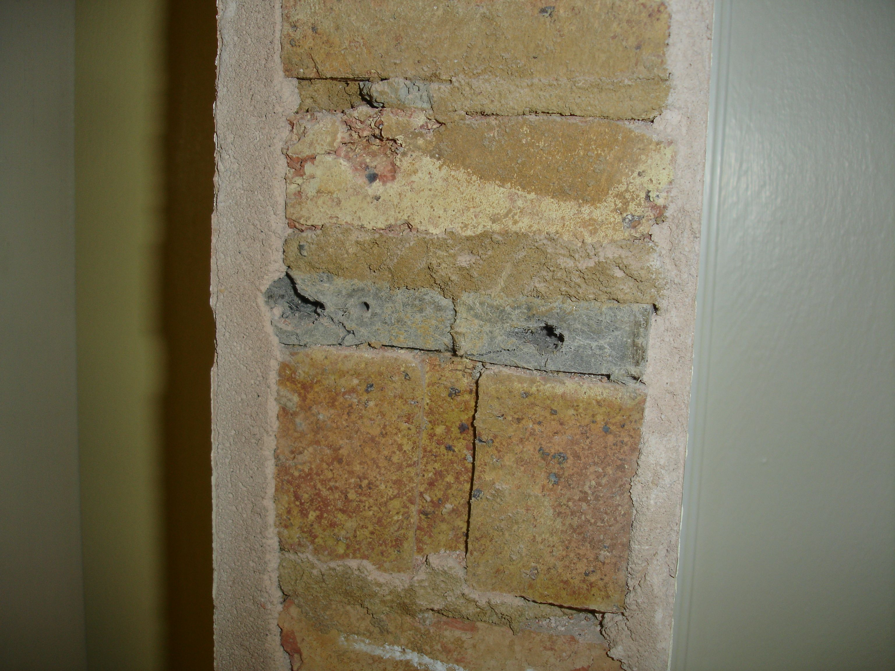 Asbestos fixing blocks embedded in brickwork. Identified on removal ...