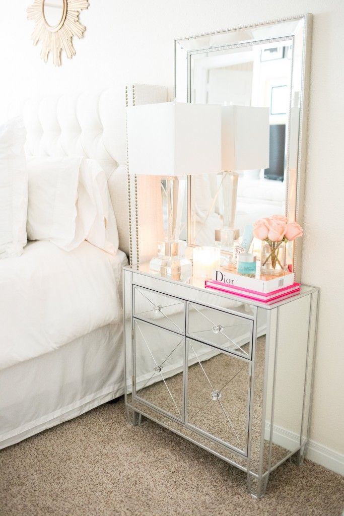 White Bedroom With Nightstand Mirror And Decorative Mirror Above Bed.