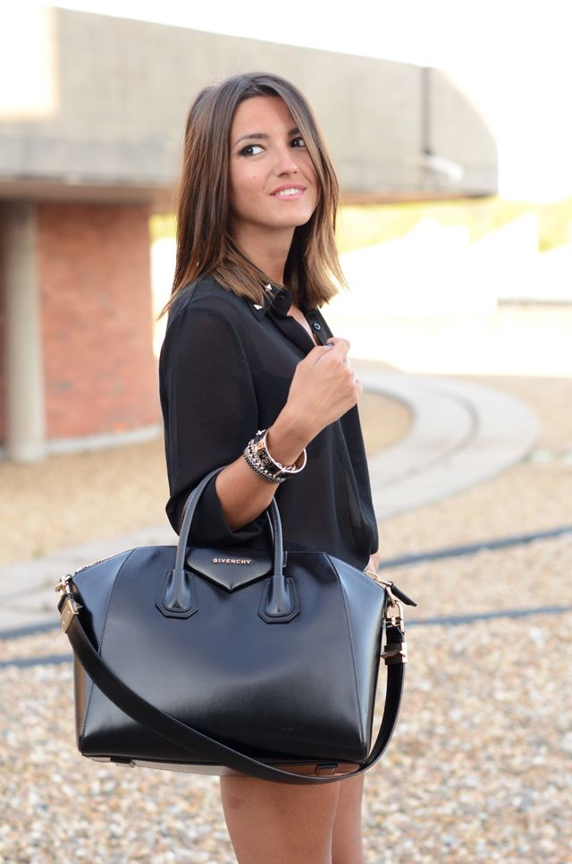love this Givenchy bag with the sheer black shirt