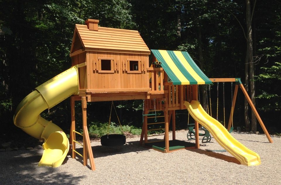 This fantasy tree house wooden swing set features a spiral for Tree house swing set