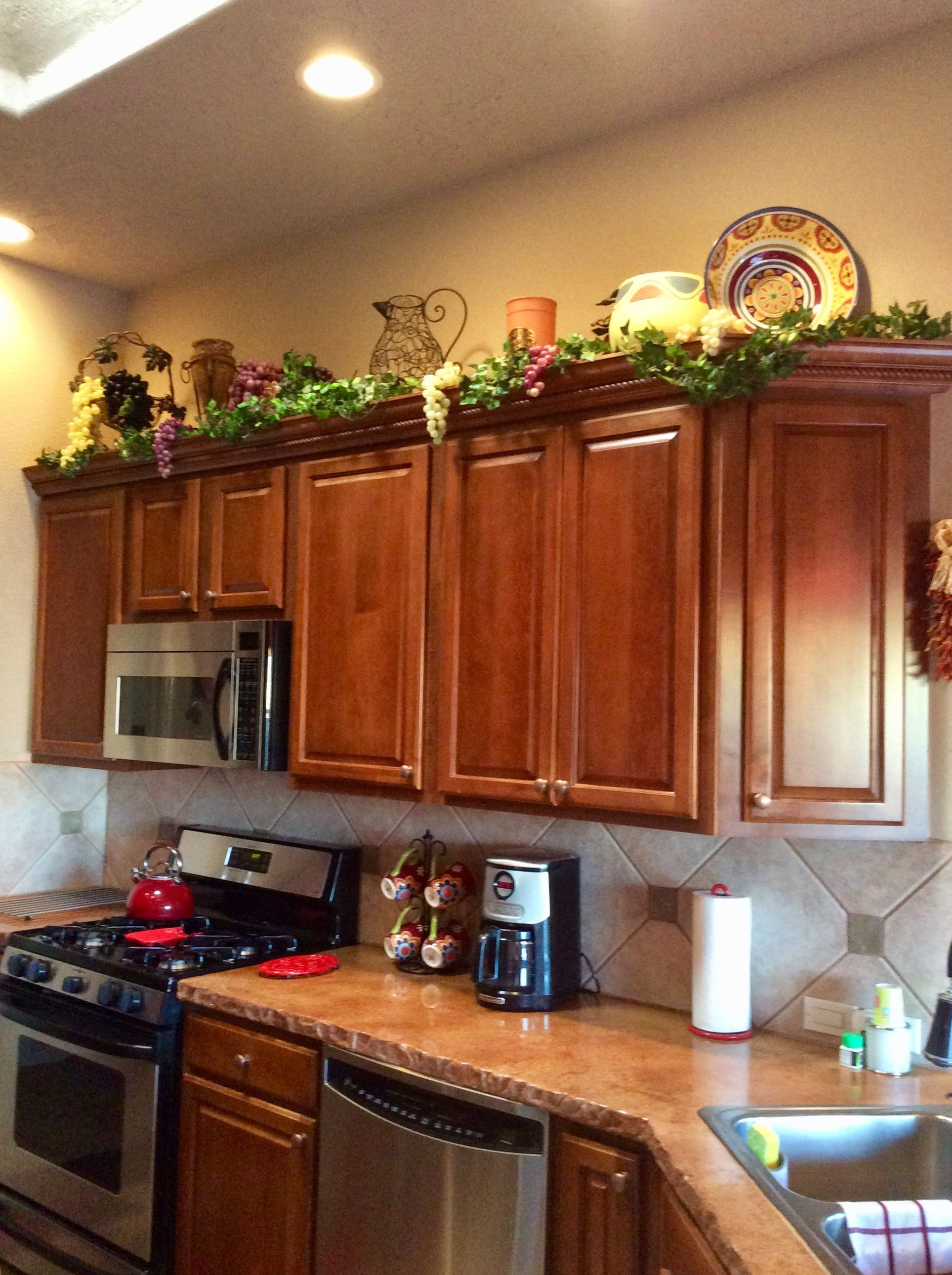 Decorating above the kitchen cabinets.  ...