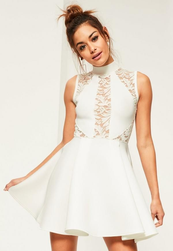 This dress officially passes the twirl test! Make it yours with its fresh white hue, high neck, figure-structuring scuba fabric and a lace panels for a sexy edge.