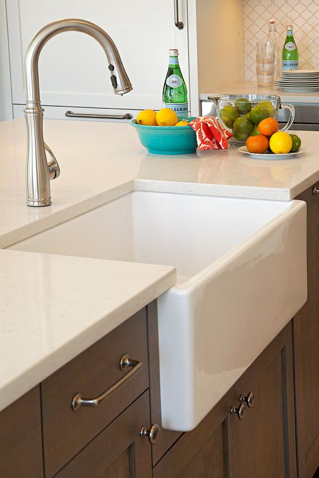 Merveilleux Kitchen Island Is Topped With White Quartz Fitted With A Farmhouse Sink And  Satin Nickel Gooseneck Faucet. Blend Interior Design.