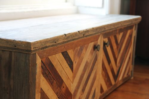 She set this salvaged wood bench into a window nook and placed a buckwheat-hull filled cushion on top... beautiful