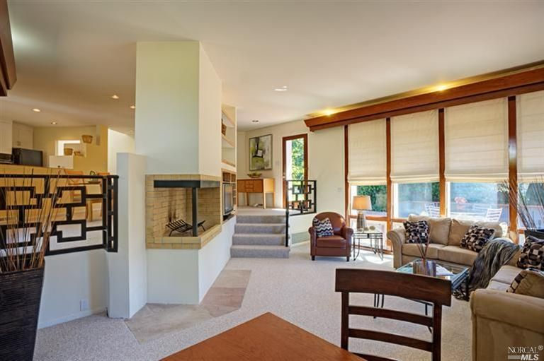 Step Down Living Room With Built In Accent Lighting Raised Fireplace And