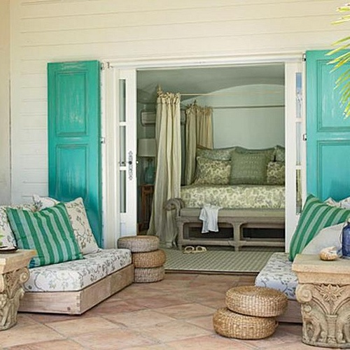 A Neutral Beach Living Space With Bold Turquoise Touches