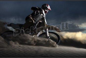 Man Riding Dirt Bike in Sand Dunes