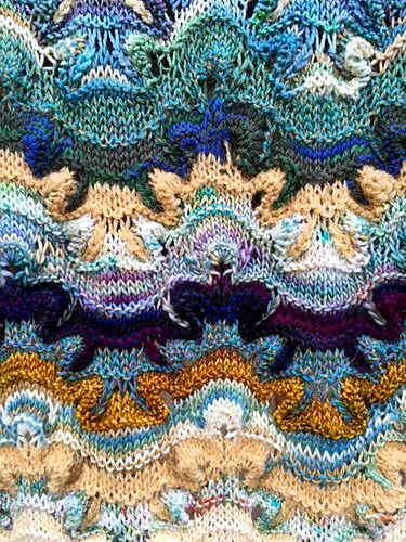 Yarn, color and pattern combine in Jacaranda - an intriguing lace shawl with hints of chinoiserie in its fluid wavy zigzag curves.