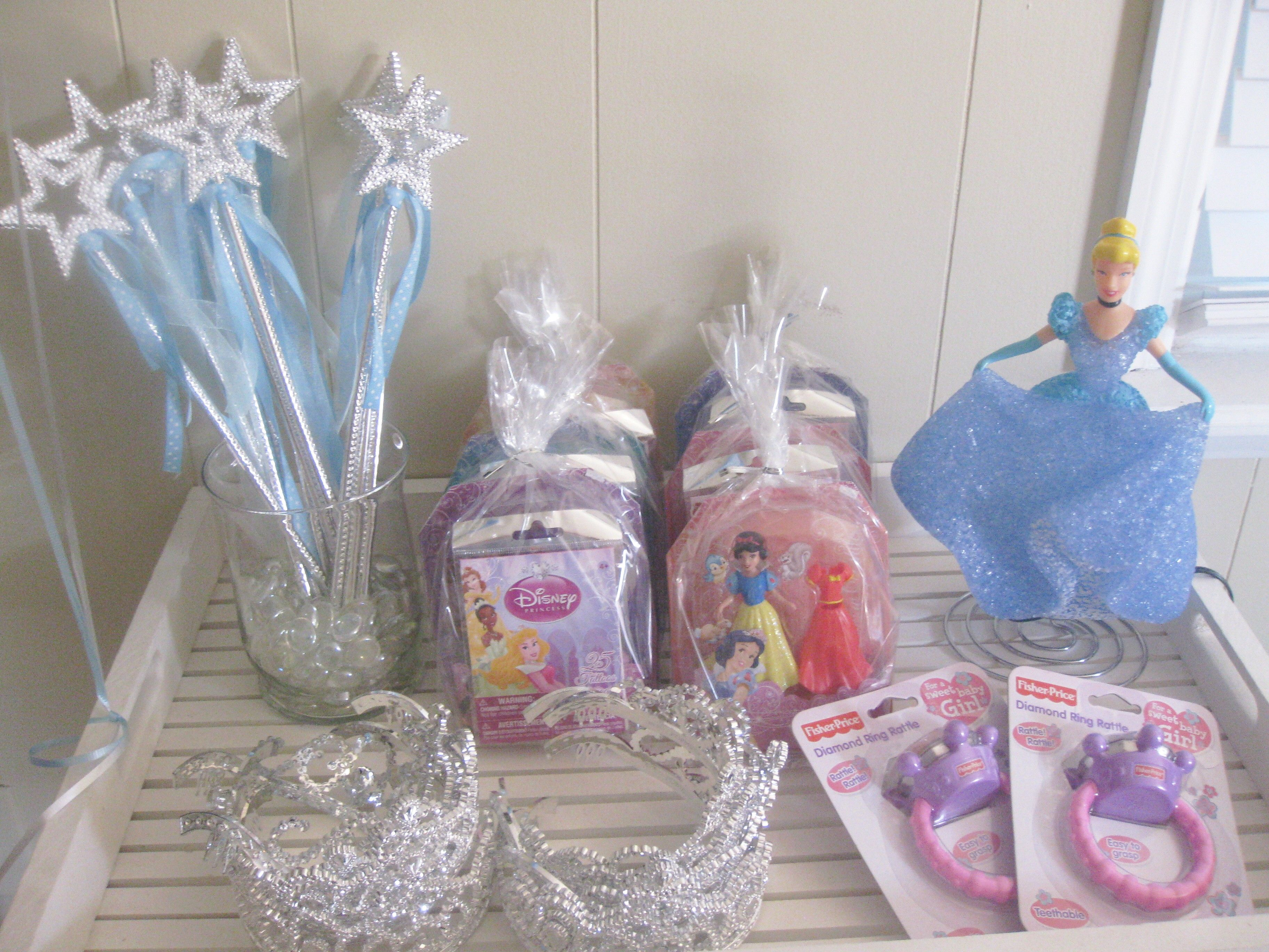 Cinderella Favor Table With Wands Tiaras Goody Bags And Teething Rings For The Tiny Princesses