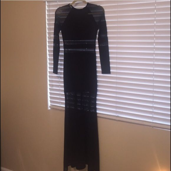 Nasty Gal Long Sleeve Black See Through Mesh Dress What you see is what you get! Dress had NEVER been worn! There are no tags tho..in perfect condition. Fit to the body so it looks very sexy on! Stretchy too! Love this dress! PRICE IS SET!!! No trades!! Nasty Gal Dresses Maxi