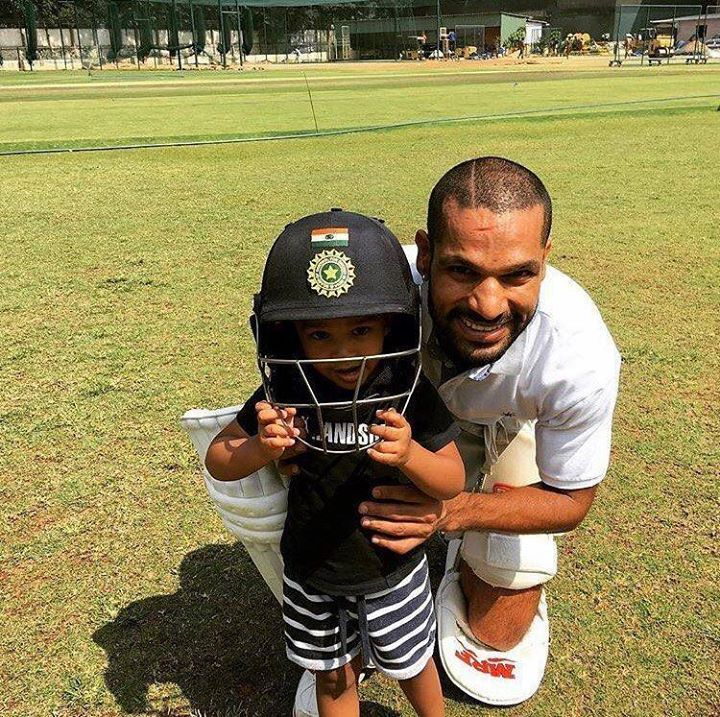Shikhar Dhawan with his son at a practice session http
