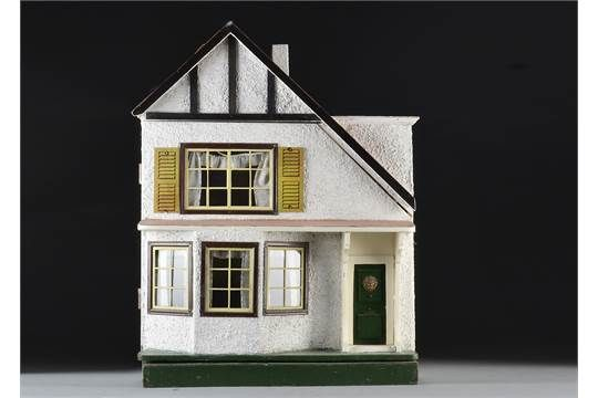 A Tri-ang A-symmetric dolls' house DH/D 1924, with pebble-dashed exterior, ground floor bay windo