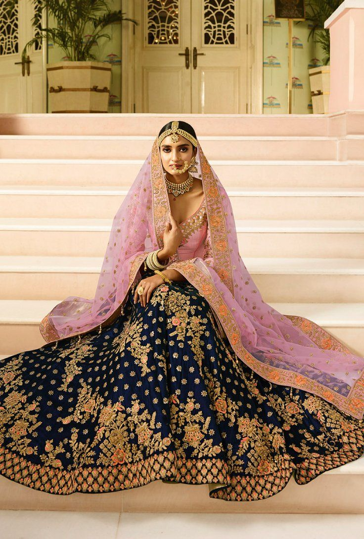 dc2ea9554 Featuring pink and blue bridal lehenga set with heavy intricate thread  embroidery on top