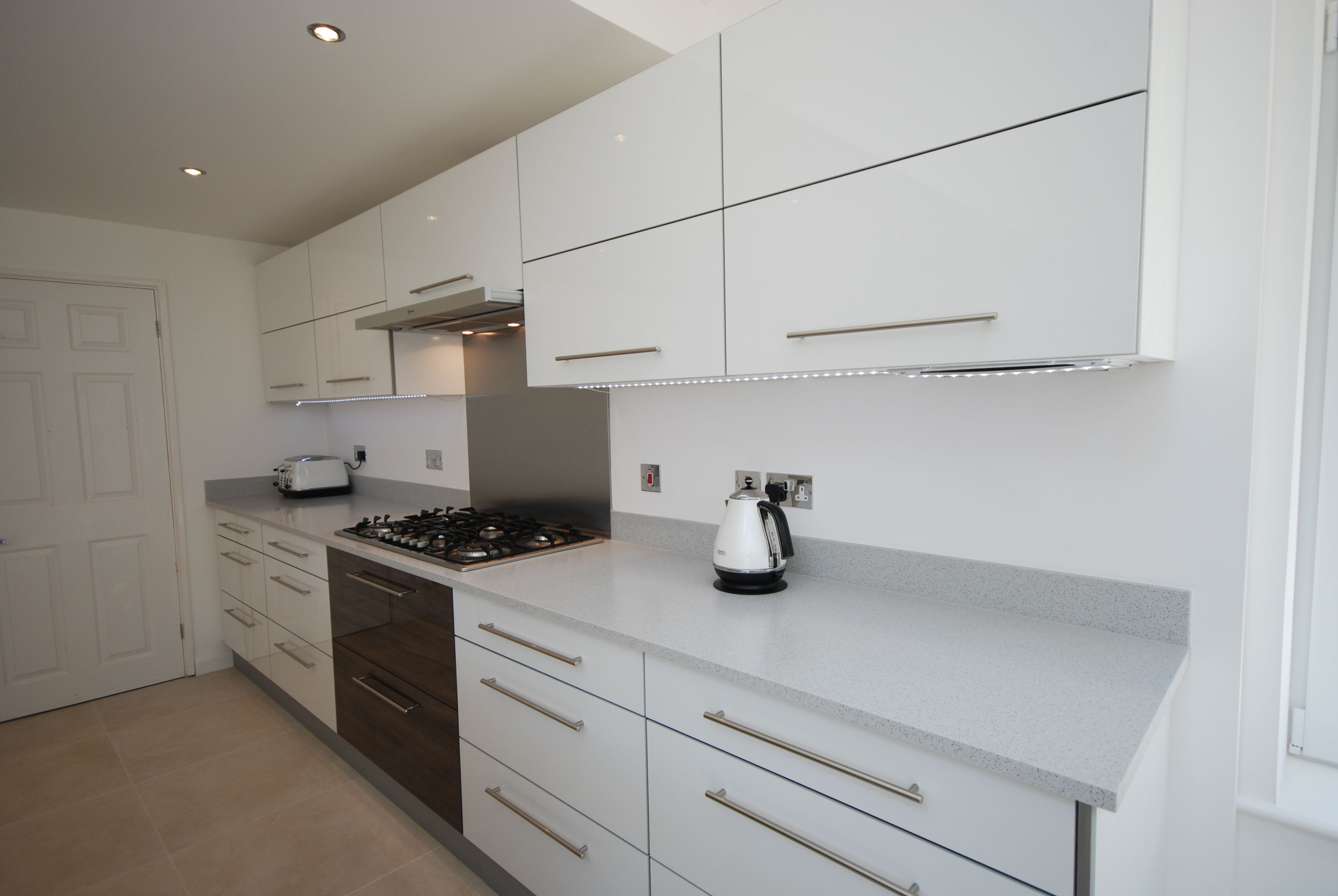 Fusion White Gloss and Dark Pacific Walnut kitchen with Mistral ...