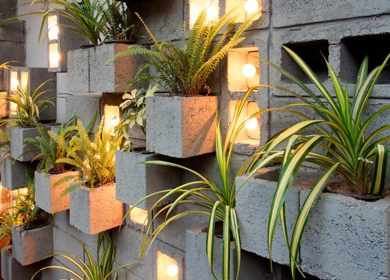 A Concrete Block Planter Wall Was Used To Add Greenery To This Restaurant In 2020 Concrete Blocks Plant Wall Small Vertical Gardens