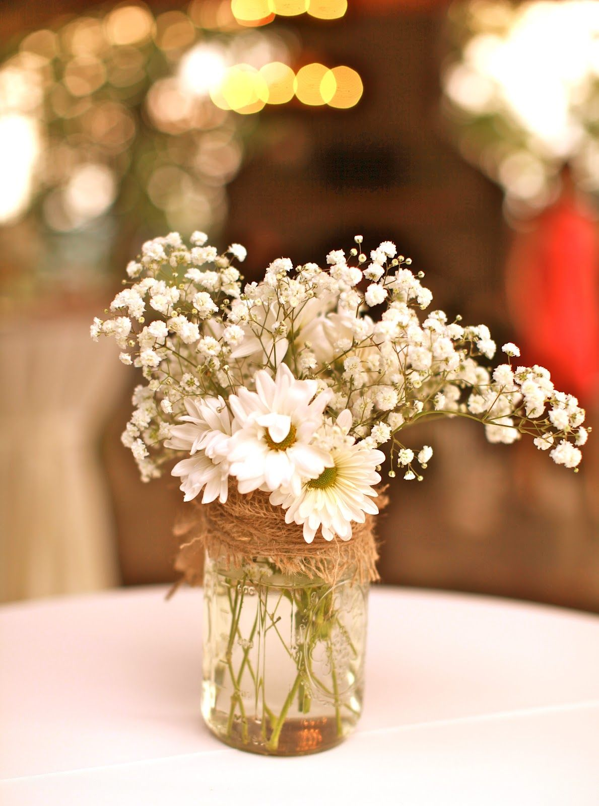 Malou Keeping Costs Down Baby S Breath And Daisies In Mason Jars For Centre Pieces Rustic Wedding Centerpieces Daisy Centerpieces Wedding Flowers