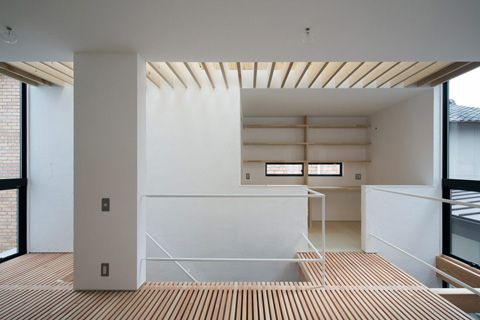 Transparency between rooms and floors assume a meaningful role when dealing with a small space: internal walls are almost nonexistent in order to enhance views and natural daylight throughout the entire house. small-house-smamoto-cd2