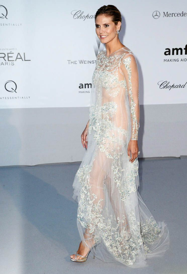 A dreamy sheer gown with a perfect balance of embellishment by ...