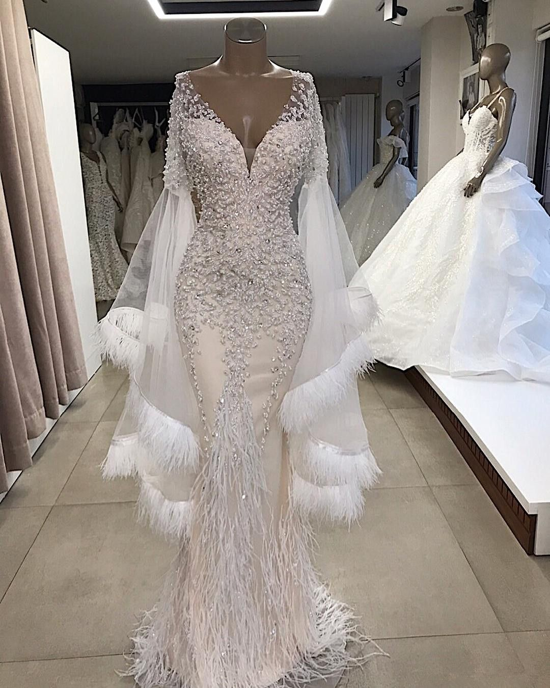 Plunging Neck Sparkly Evening Gown With Feather  Prom dresses