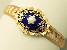 An exceptional and stunning antique Victorian natural pearl, 0.06 carat diamond and blue enamel, 18 carat yellow gold bangle; part of our bangle and bracelet collection  SKU: W8999 Price    GBP £2,250.00 http://www.acsilver.co.uk/shop/pc/Pearl-0-06-ct-Diamond-and-Blue-Enamel-18-ct-Yellow-Gold-Bangle-Antique-Victorian-p6090.htm