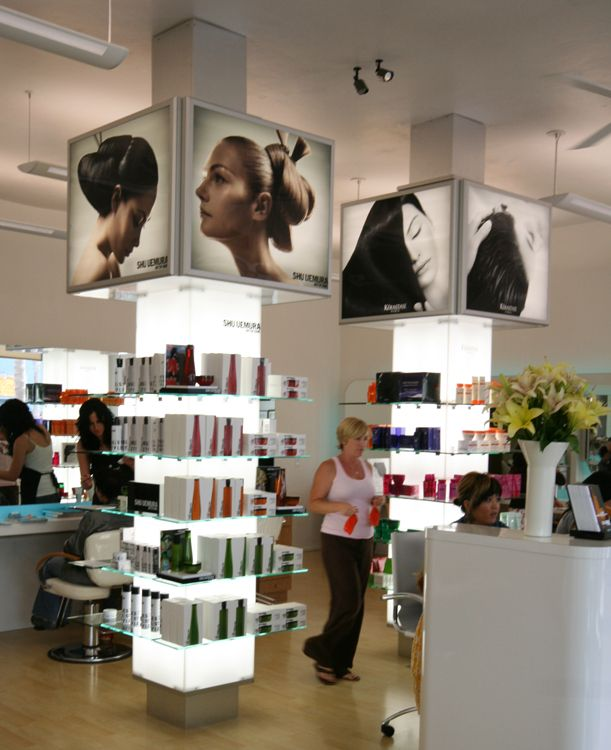 The pillers for retail with the long lights coming from for Salon kerastase paris