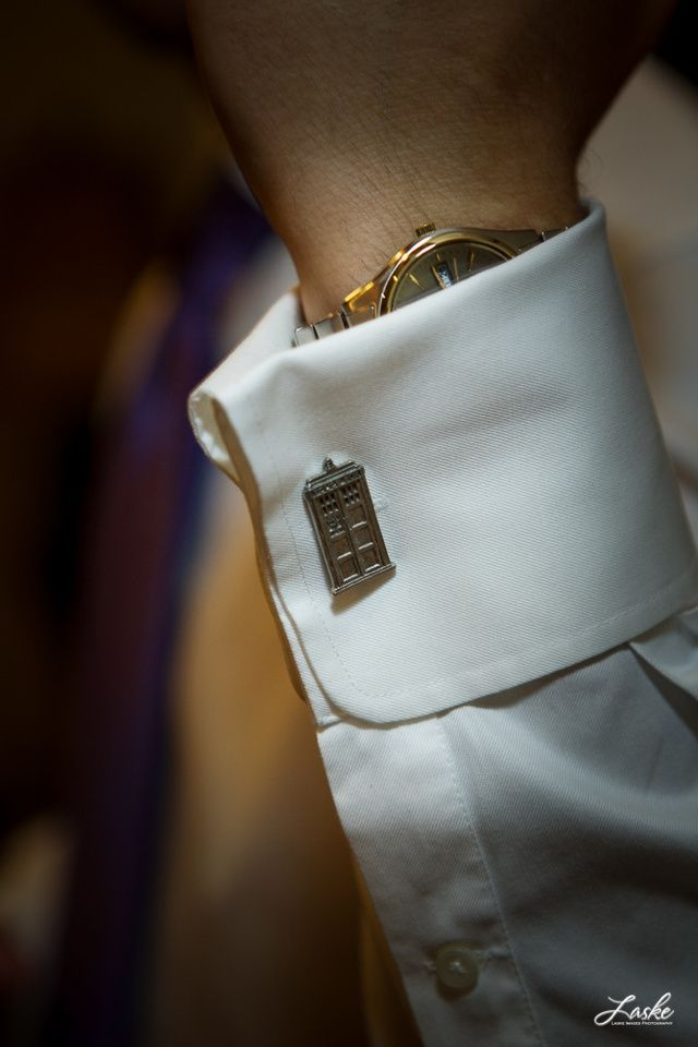 Tardis cufflinks on the groom at a Doctor Who-themed wedding