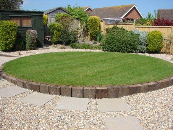 circular raised lawn with railway