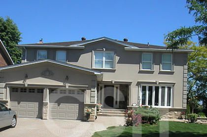 Grey brick home with stucco brick and stucco home with for Stucco and brick homes