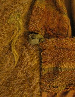 995 - 1029 AD, shirt from Skjoldehamn, Norway. Detail of bead. 2/2 twill wool. found with a fully dressed bog body.