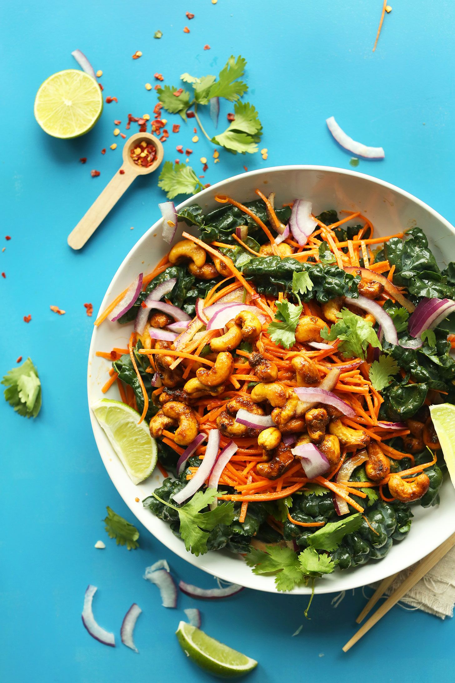 An easy, 30-minute Thai-inspired carrot and kale salad with a savory-sweet dressing and curried cashews! Flavorful, hearty, so delicious!