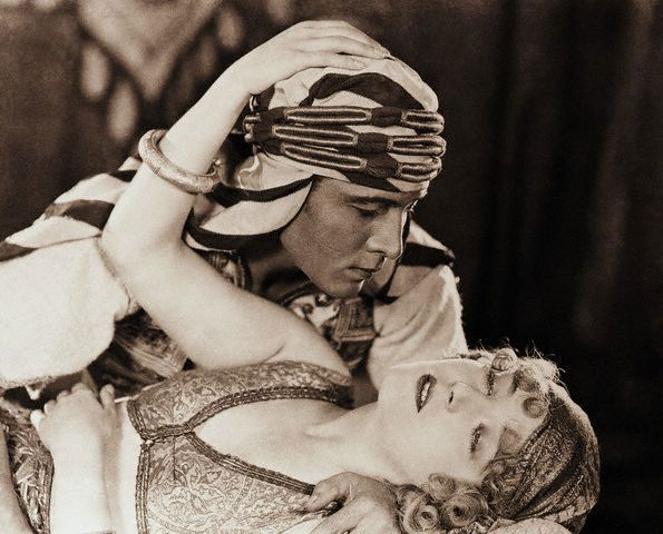 The man and the movie that made women swoon. Rudolph Valentino and Agnes Ayres in The Sheik, 1921.