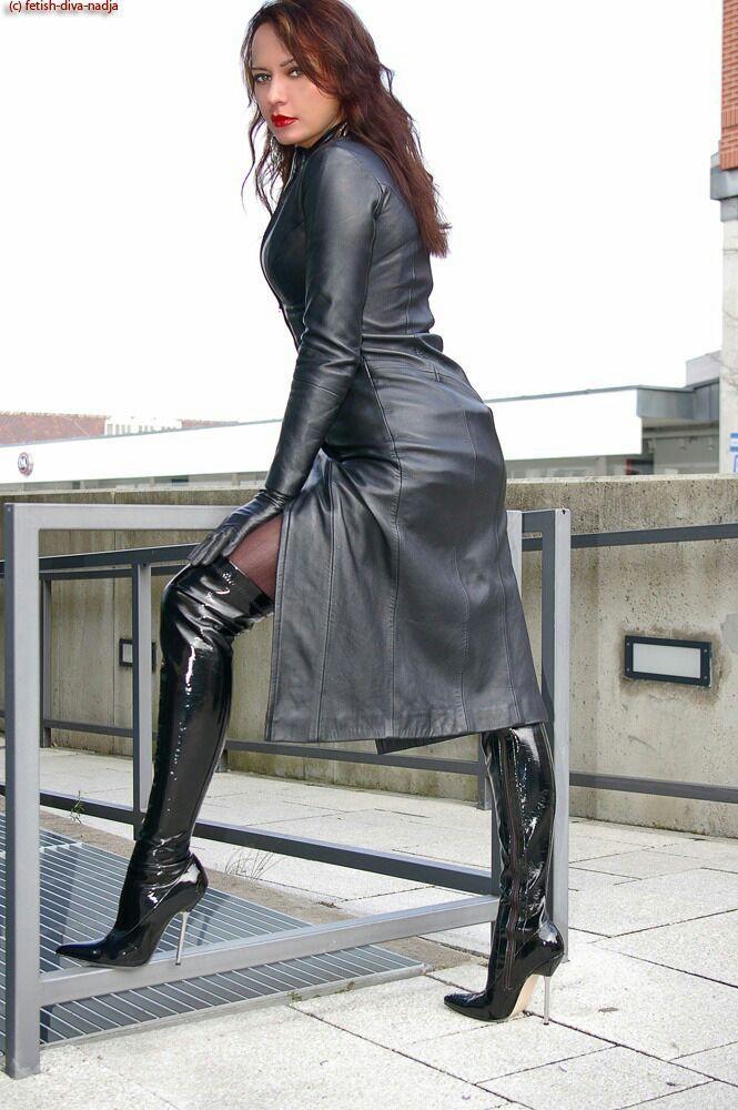 Stylish black leather boots in white background stock image