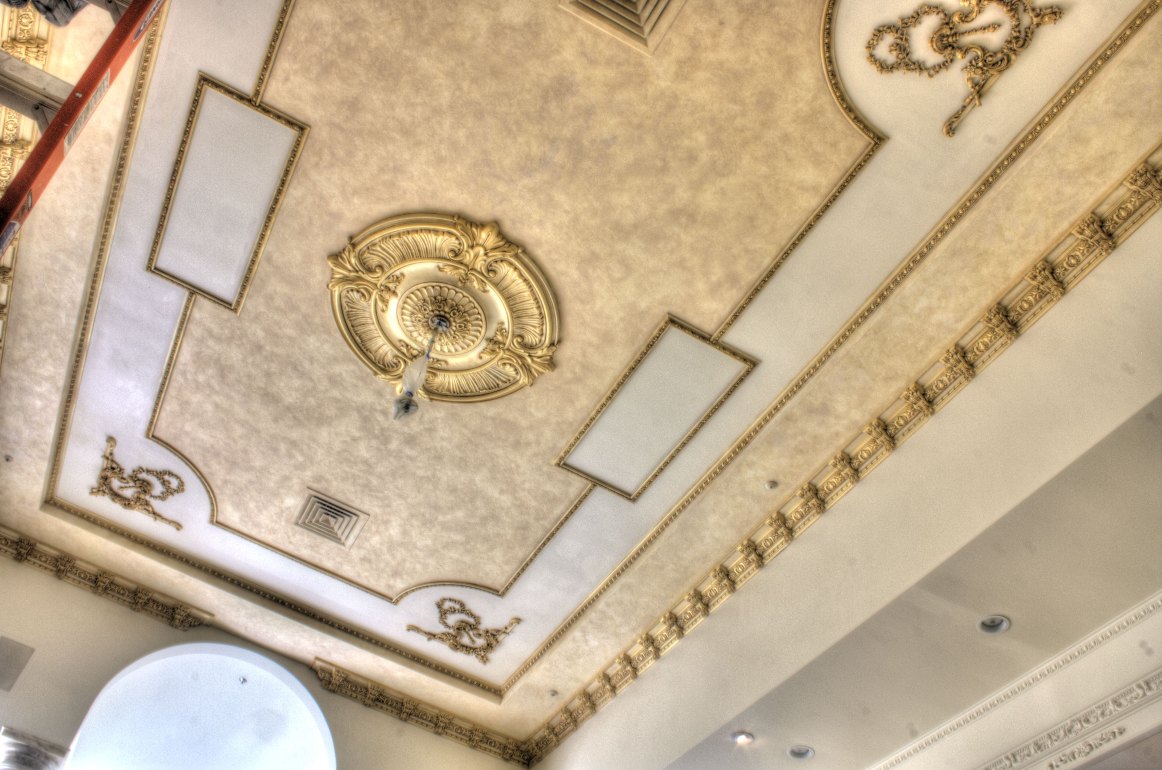 Antique Gold Metallic Paint Finish applied to decorative moldings on ...