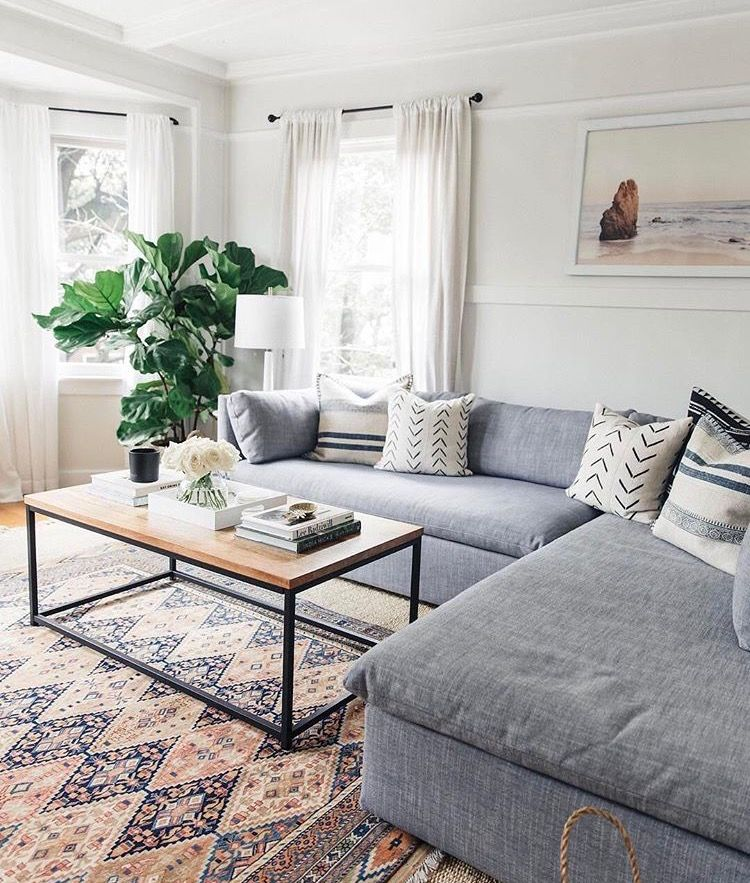 Living Room Cozy Couch Patterned Carpet Minimalist Table