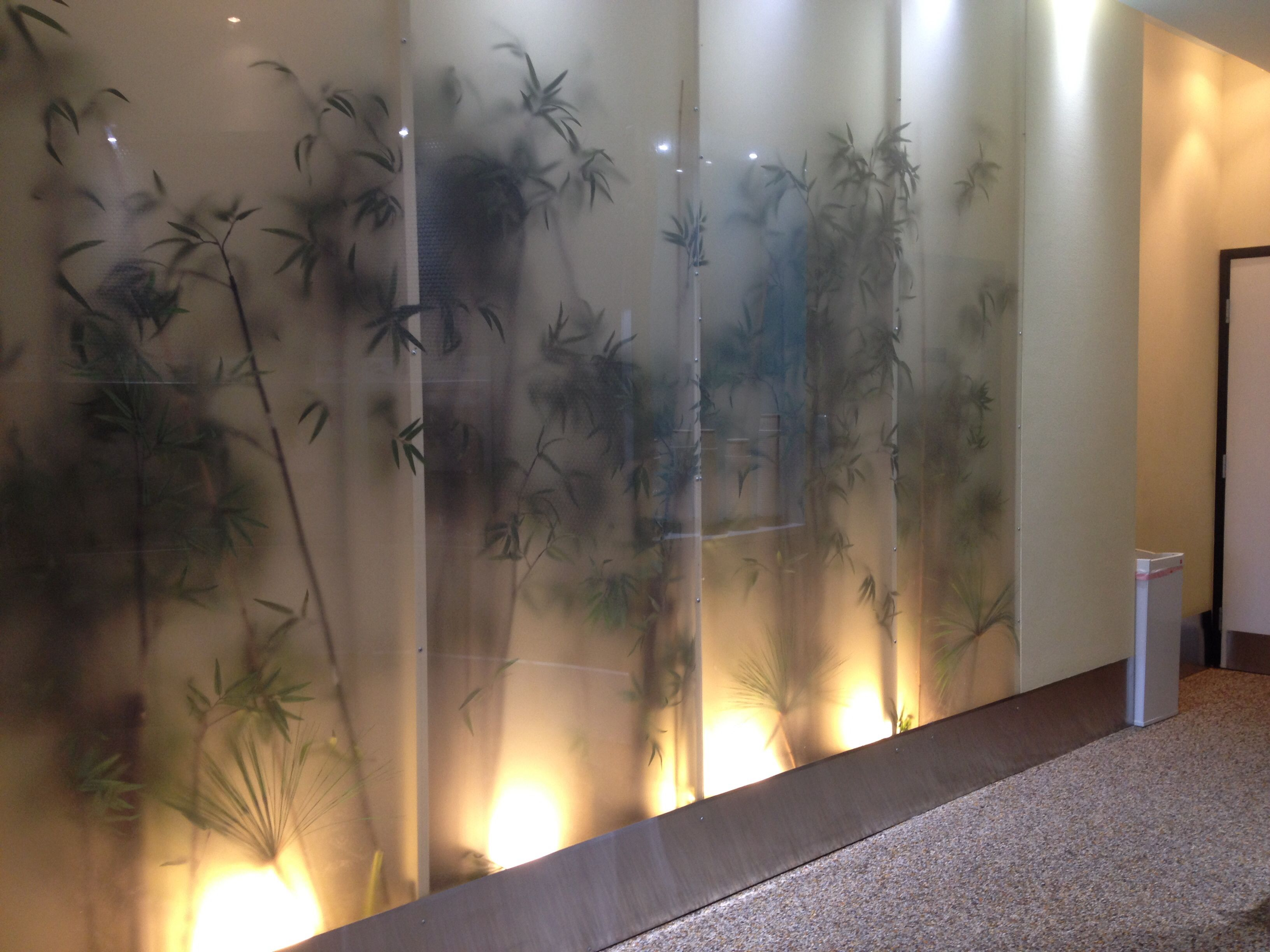 Silk plants behind frosted glass gives a jungle feel for