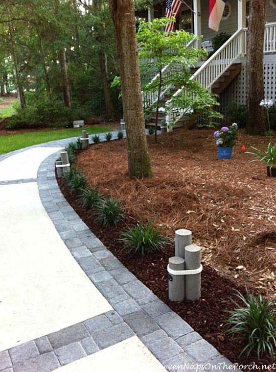 Concrete Walkway Transformed With Beautiful Cobble Stone Pavers Concrete Walkway Walkway Design Concrete Path