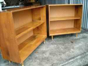 Matching midcentury bookcases. Would it be sacrilege to lacquer them? ;-)
