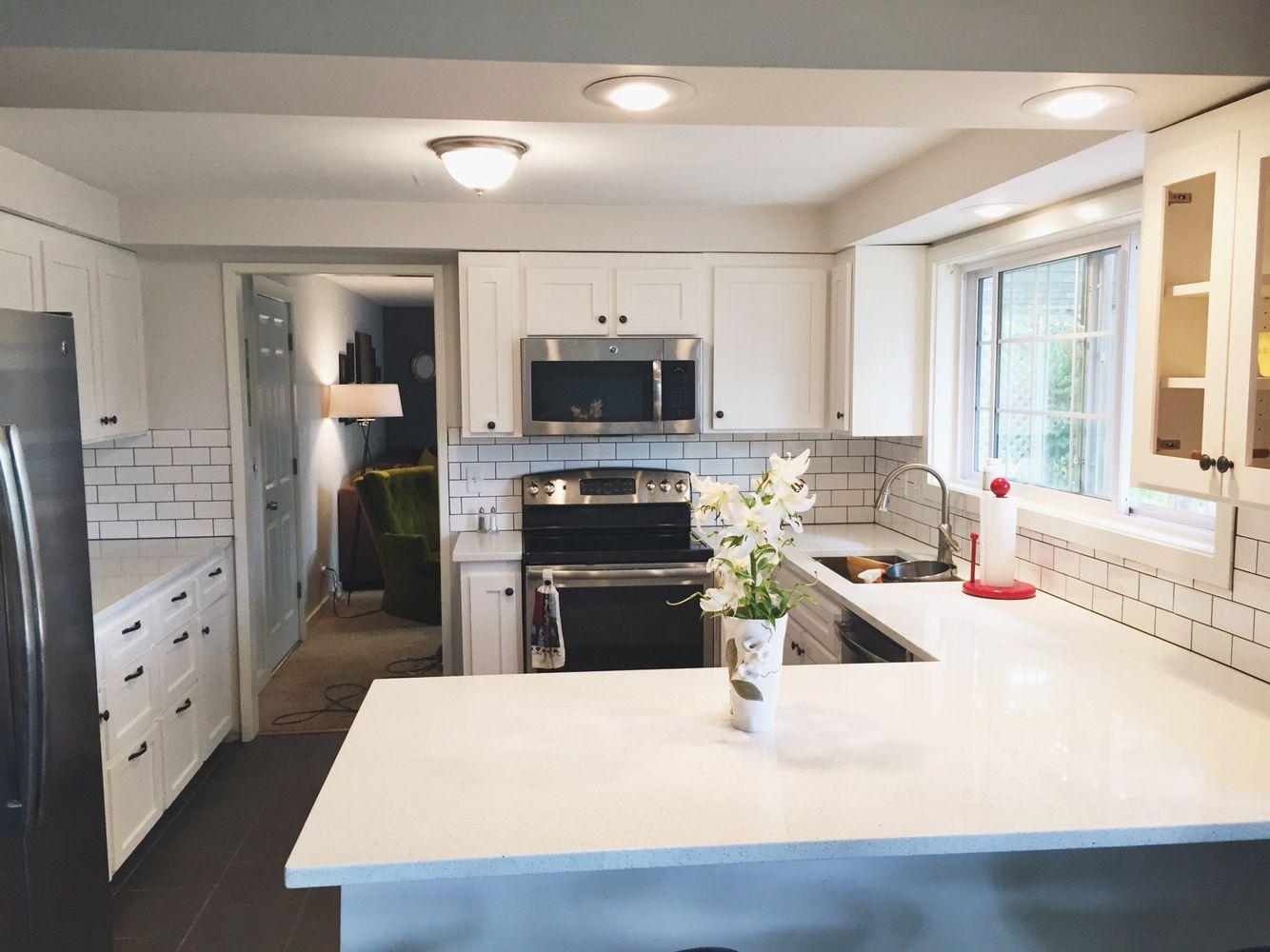 Light and bright white kitchen. Sparkling white Quartz