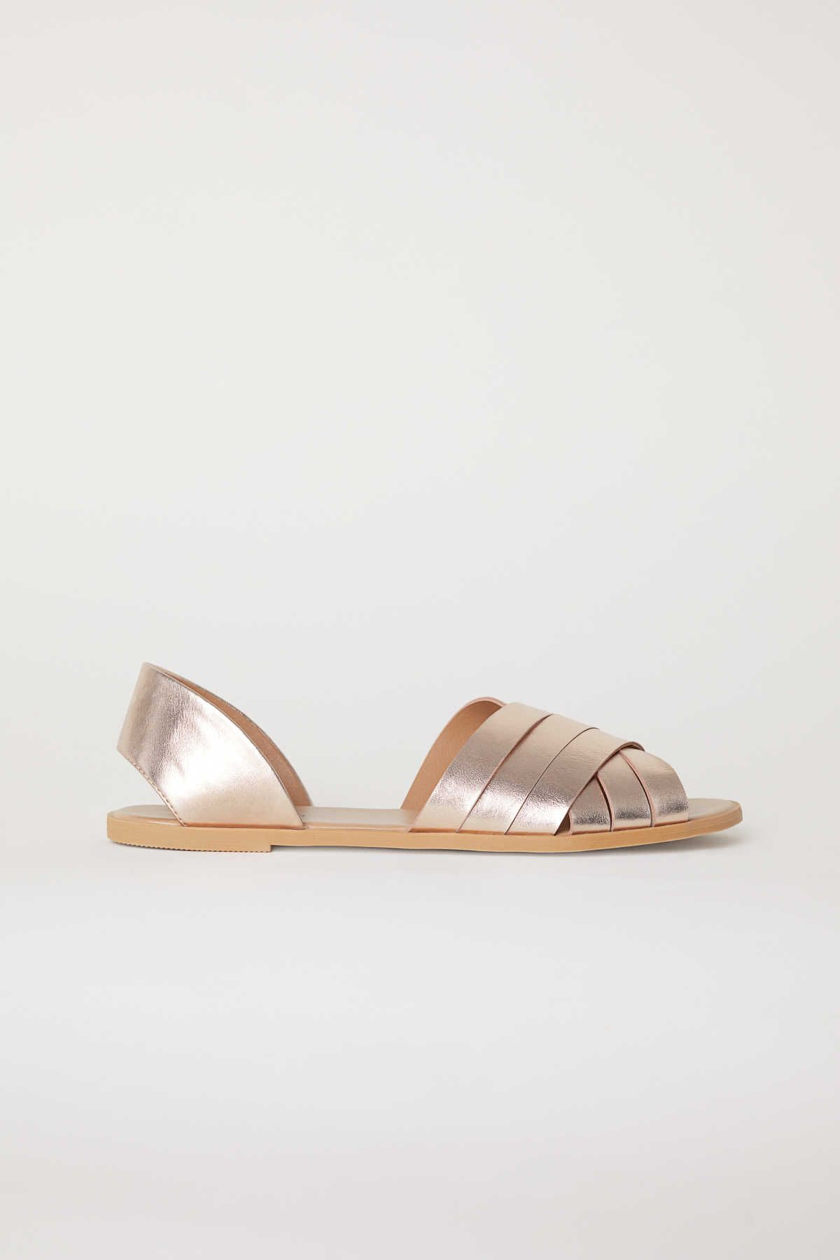 f1be17033 Rose gold-colored. Sandals with crossover front straps and open sides. Faux  leather insoles and rubber soles.