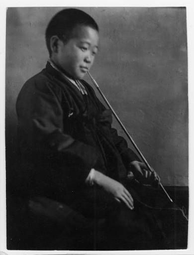 Korean boy with pipe, Chungwha, Korea, 1929 :: International Mission Photography Archive, USC. (High res available at site)