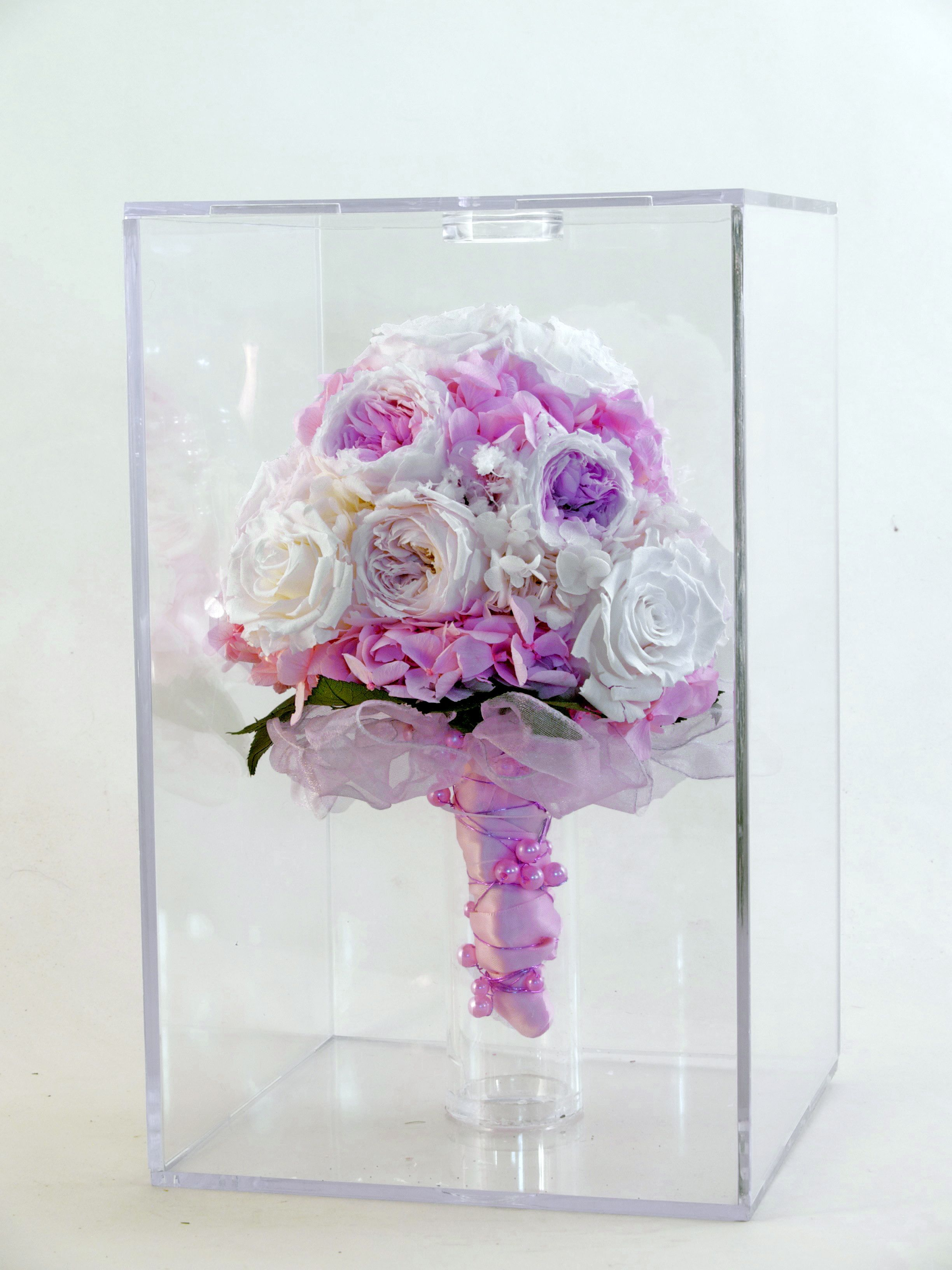Bridal bouquet of unique preserved roses in a display and
