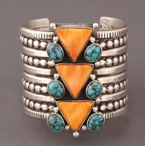 Wow! Stunning sterling cuff adorned with turquoise and another beautiful orange-toned stone. Not sure what it is but I love it!