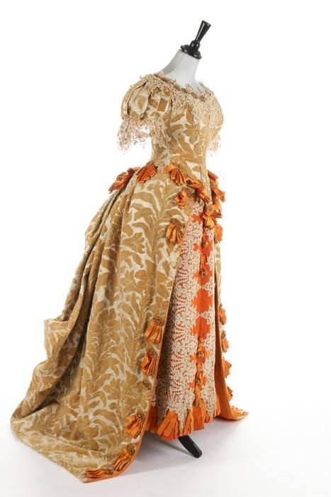 "Ball gown, by the House of Worth, ca. 1885-1888 From Kerry Taylor Auctions: ""This is a rare Charles Frederick Worth historically-inspired voided velvet ball gown. This dress combines all the elements one seeks to find in a Charles Frederick Worth dress - fabulous textiles combined with historicism and high fashion. Worth produced lavish 17th century inspired evening gowns throughout his illustrious career."