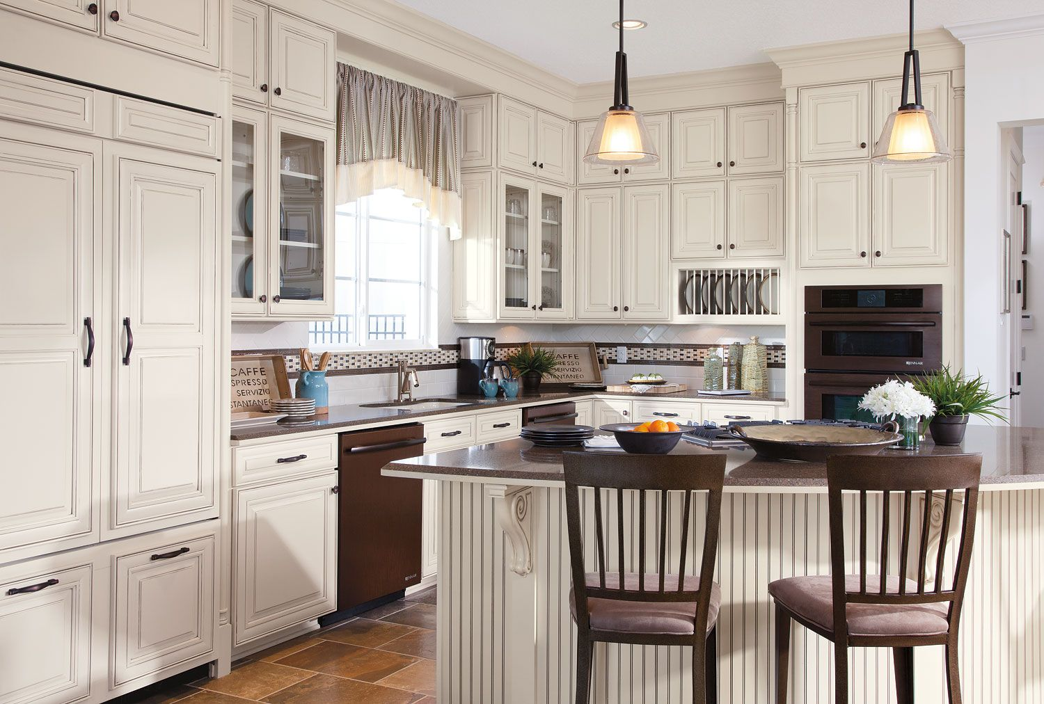 Beautiful white kitchen with timberlake cabinets and decorative