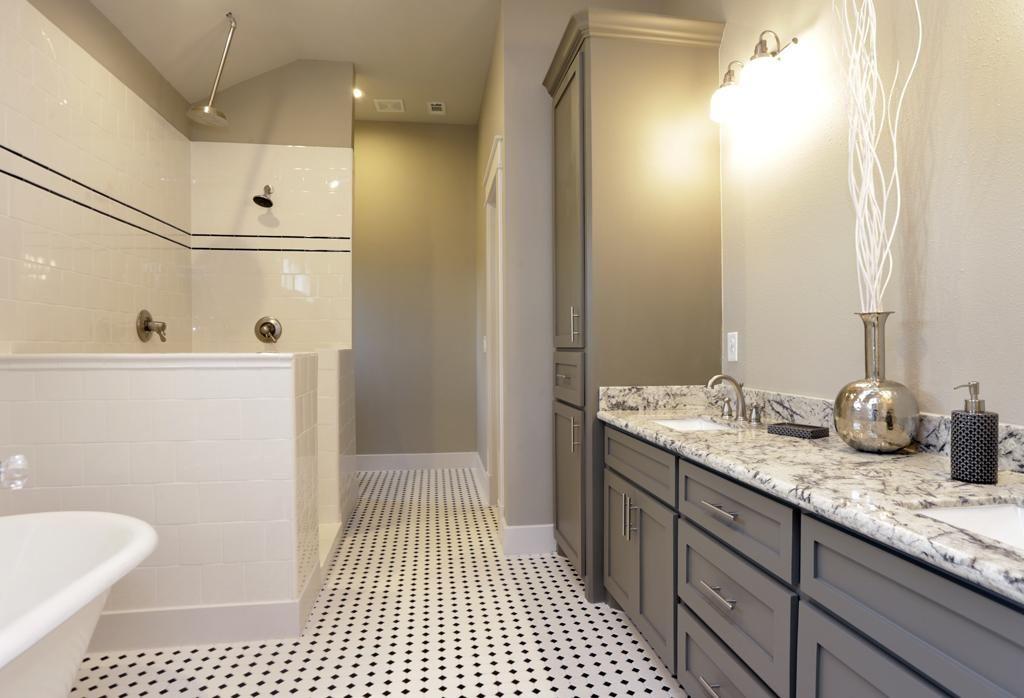 Master bath with a clawfoot tub and rain shower heights Rehab