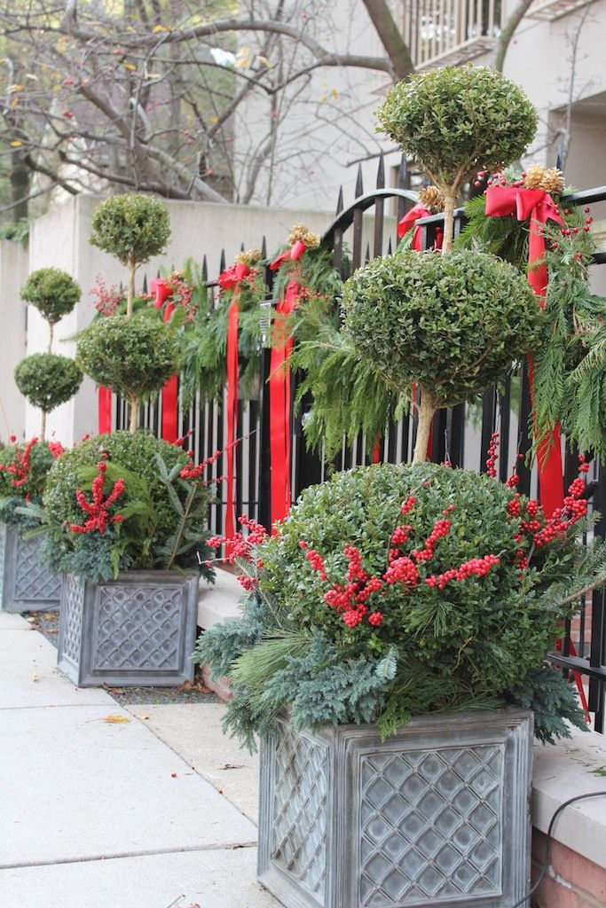 Beau Holiday Topiary And Gate Decor. A Touch Of Red Ribbon And Greenery Say  Christmas!
