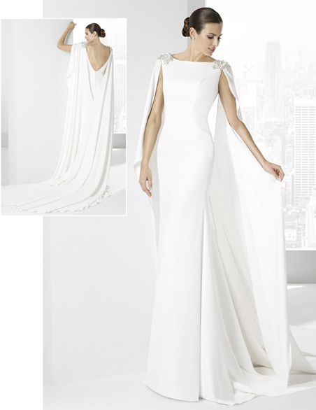 traje de novia en crep natural con capa sujetada al hombro