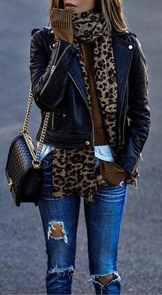 Leopard scarf, blue jeans, and black leather jacket.