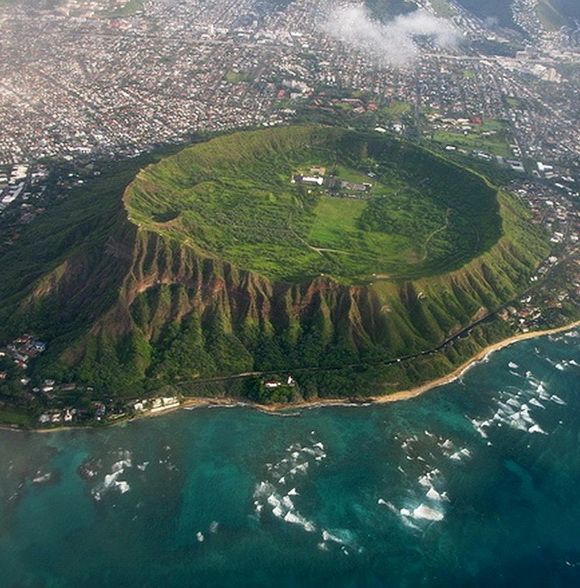 Imagine growing up on *this* farm.....!  (10 Unusual Volcanic Craters -- go see them all... amazing!)