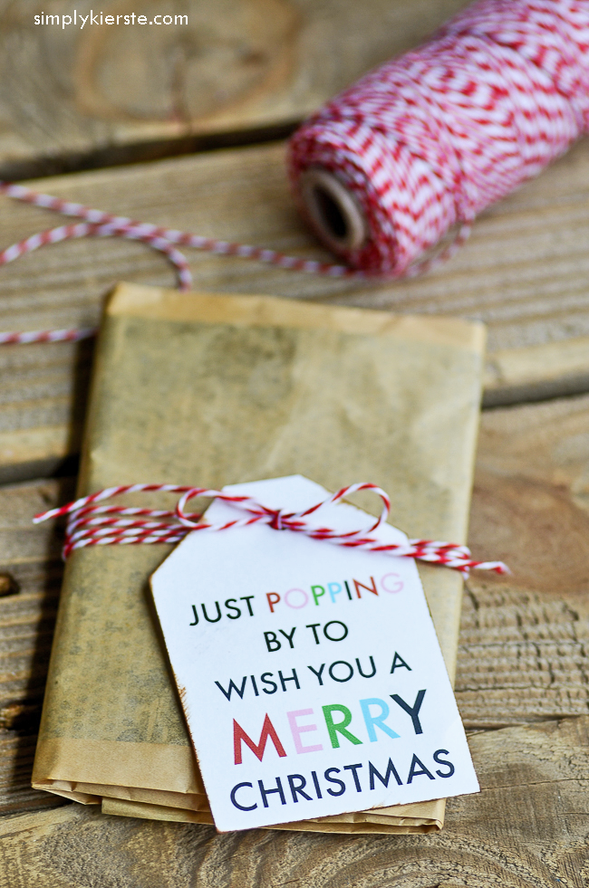 a super cute easy christmas popcorn gift idea tie this darling tag onto a bag of microwave popcorn and give it to friends colleagues teachers more